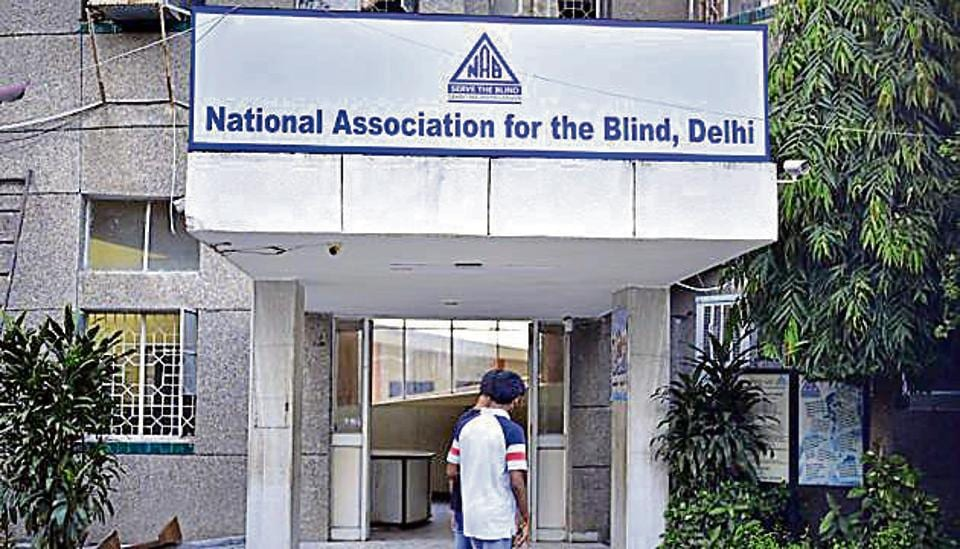 A British man has been arrested for alleged sexual abuse of visually impaired children at the National Association for Blind home .