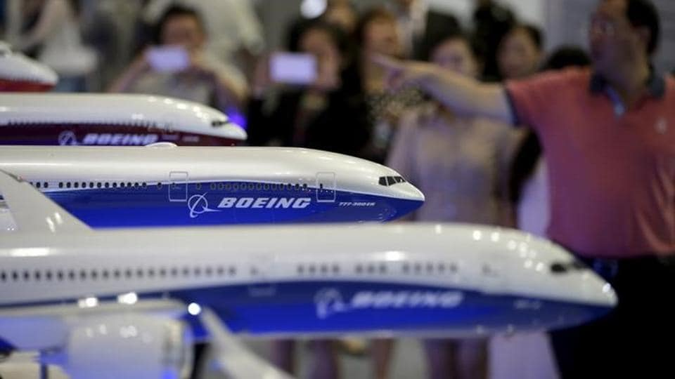 Visitors look at models of Boeing aircrafts at the Aviation Expo China 2015, in Beijing, China, in this September 16, 2015.