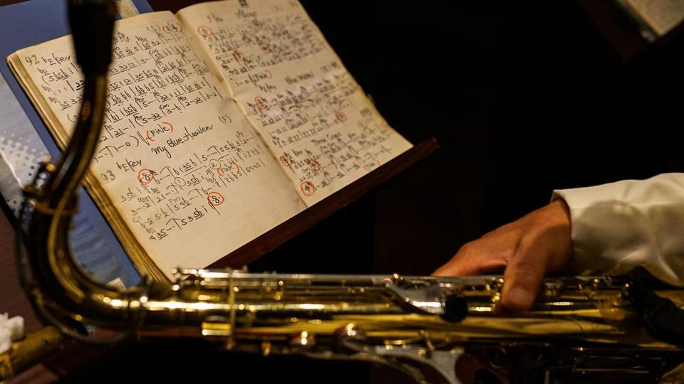 Seen here are music notes of a member of the 'Old Jazz Band' kept open during his performance in Shanghai. Former US presidents Bill Clinton and Ronald Reagan are among the dignitaries who dropped in for an evening of jazz -- Clinton, who plays the sax, even joined in.The band, which has an average age of 82, plays what it calls 'soft jazz' with a Shanghainese flavour. (Chandan Khanna / AFP)
