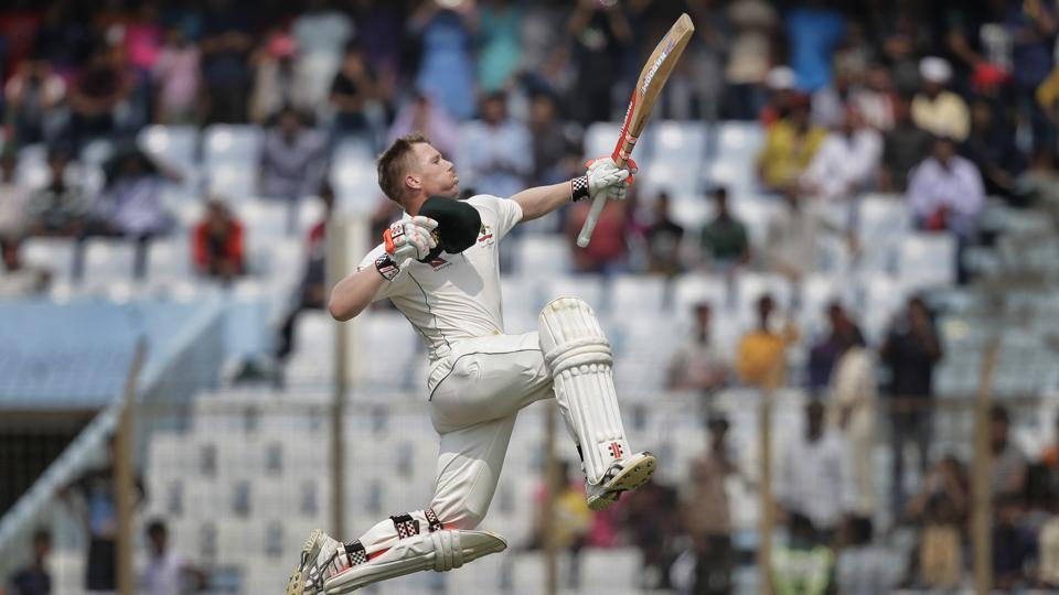 Australia's David Warner jumps in the air in celebration after scoring his 20th hundred against Bangladesh in Chittagong.