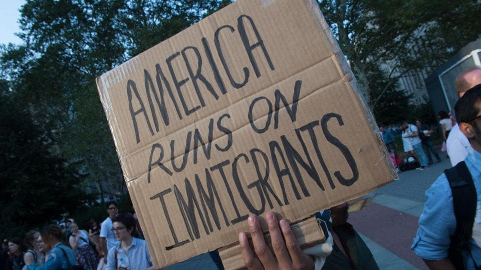 Protesters hold signs at a rally to defend DACA in New York on September 5.