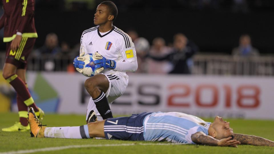 Argentina national football teams's Mauro Icardi (R) expresses his anguish after Venezuela goalkeeper Wuilker Farinez foiled his attempt at goal during their FIFAWorld Cup qualifier match in Buenos Aires, on Tuesday. Jorge Sampaoli's side, despite Lionel Messi trying his best, was held by the visiting team.