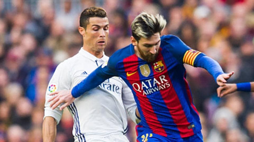 Cristiano Ronaldo (L) and Lionel Messi are once again the front runners for the Ballon d'Or this year.