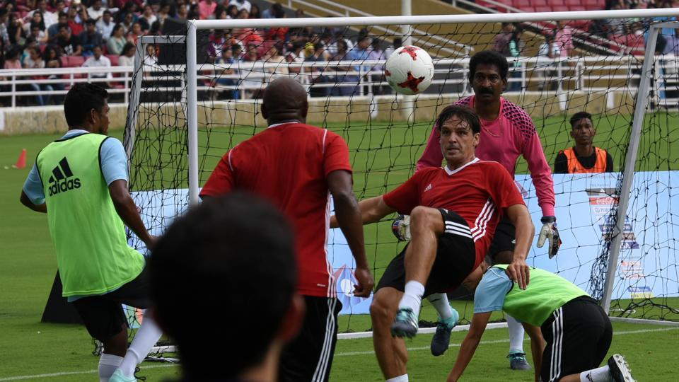 Ex-Spanish player Fernando Morientes, who played in two World Cups, in action. Henry Menezes is the goalkeeper. (Hindustan Times)