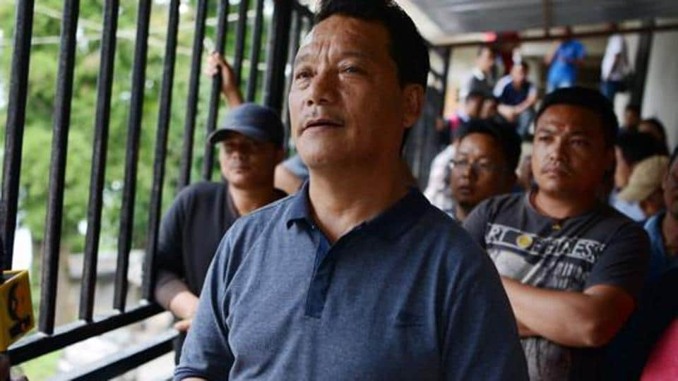 (FILES) This file photo taken on June 14, 2017 shows Bimal Gurung, head of the Gorkha Janmukti Morcha (GJM) party that seeks the creation of a separate state of Gorkhaland, taking part in a news conference in Darjeeling.