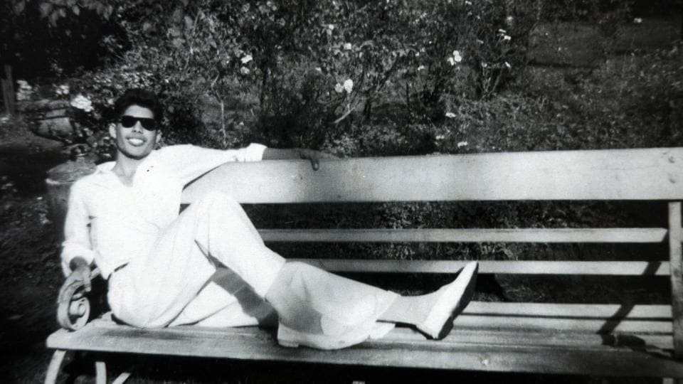 Freddie Mercury relaxes in the sun on one of the benches at St. Peter's Boys School, Panchgani. Freddie Mercury, born Farrokh Bulsara, was of Parsi descent and grew up in India before his family moved to England. He was the lead vocalist of the rock band 'Queen', famous for singing 'Bohemian Rhapsody', 'We Are The Champions' and 'Crazy Little Thing Called Love' among other hits. (Kind permission of Mr and Mrs Bulsara)