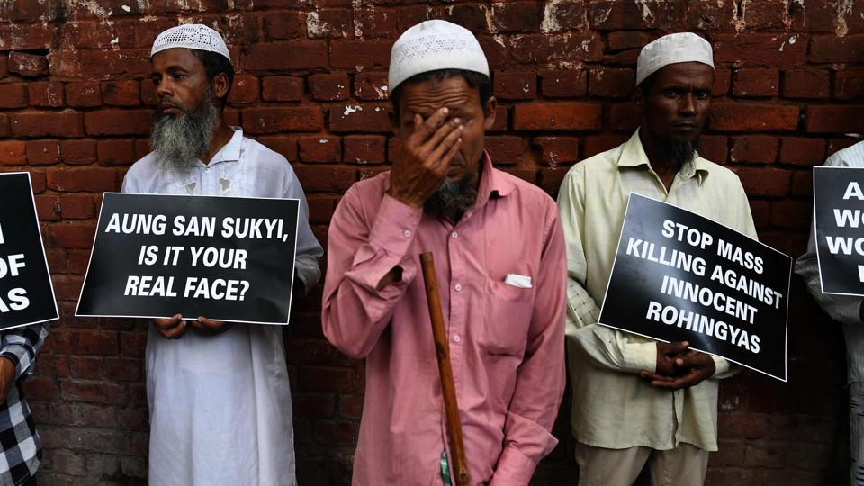 Rohingya Muslim refugees hold placards against human rights violations in Myanmar during a protest in New Delhi on September 5, 2017. Aung San Suu Kyi, Myanmar's state councillor and de facto leader has also drawn criticism from fellow Nobel Peace Prize laureate Malala Yousafzai, who decried the treatment of the Rohingyas as 'tragic and shameful'. Yousafzai also called upon Myanmar to recognize the Rohingya's right to citizenship and called upon other nations to aid in their refuge. (Prakash Singh / AFP)