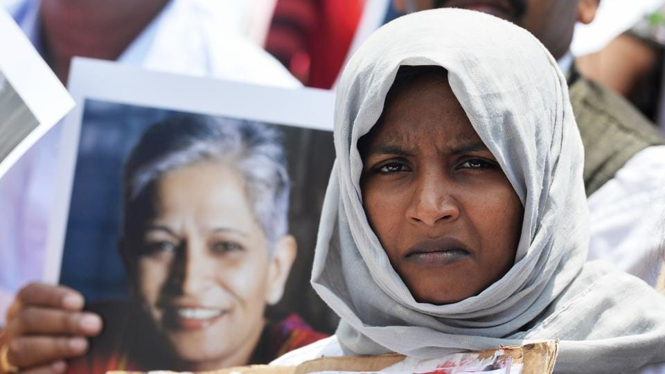 An Indian protester takes part in a rally condemning the killing of journalist Gauri Lankesh in Bangalore on September 6.