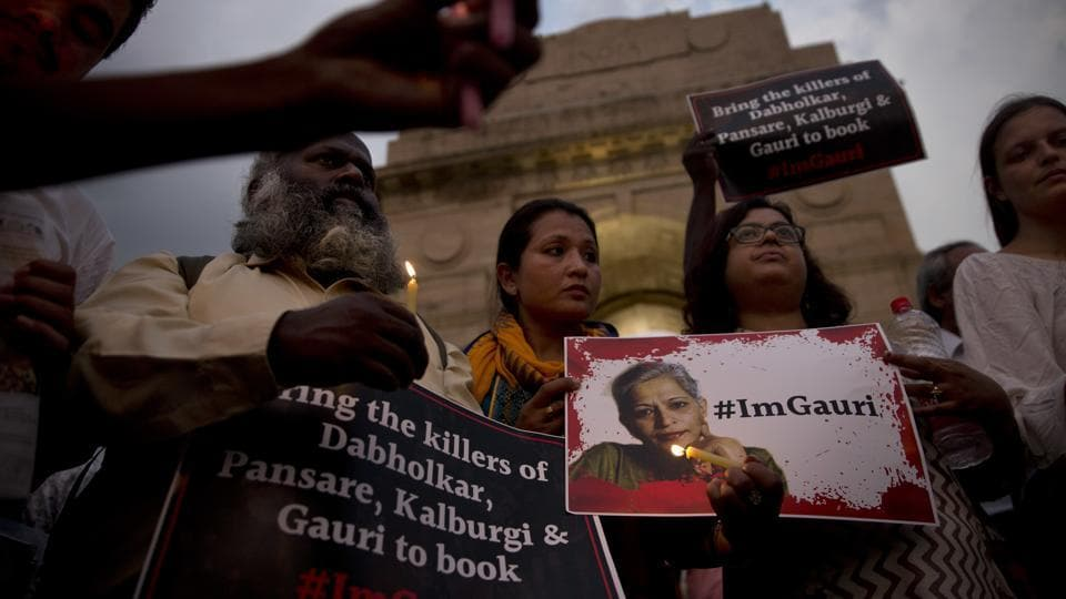 People hold candles and protest against the killing of journalist Gauri Lankesh in New Delhi on Wednesday.