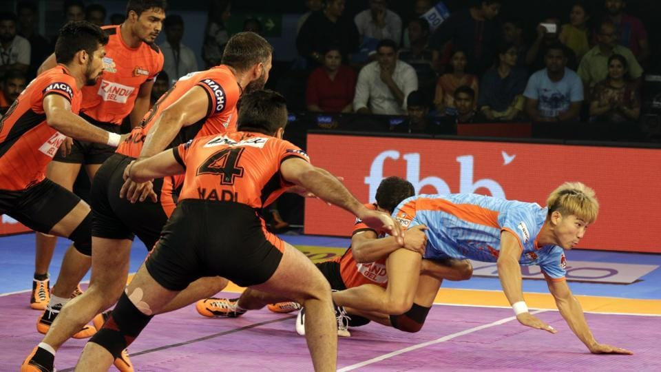 Bengal Warriors' Jang Kun Lee, light blue, is pinned down by U. Mumba players during their Vivo Pro Kabaddi league match in Kolkata on Wednesday.
