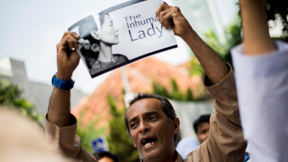 An Indonesian protester tears a picture of Myanmar's Aung San Suu Kyi during a rally in front of Myanmar embassy in Jakarta on September 2, 2017 to condemn Myanmar's army and the government of Aung San Suu Kyi. UN chief Guterres warned on September 1 of a looming humanitarian catastrophe in western Myanmar. Similar protests in support of the Rohingya were also observed in Australia, Russia, Chechnya, Pakistan and Malaysia. (Bay Ismoyo / AFP)