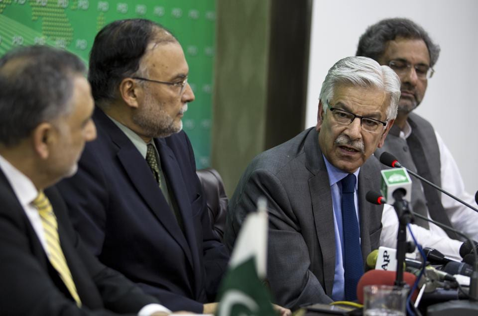 Foreign minister Khawaja Asif (second from right) along with interior minister Ahsan Iqbal and Prime Minister Shahid Khaqan Abbasi in Islamabad on July 10, 2017.