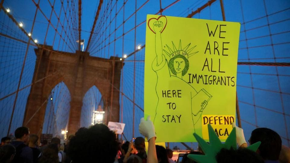 People march across the Brooklyn Bridge to protest the planned dissolution of DACA in Manhattan, New York City on Tuesday.
