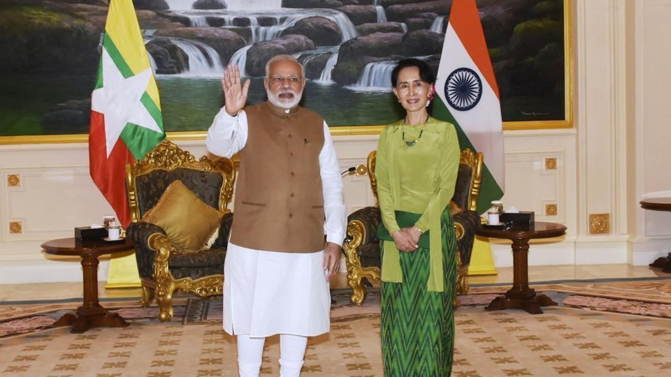 India's Prime Minister Narendra Modi waves as he poses for a photograph with Myanmar's State Counsellor Aung San Suu Kyi (R) in Naypyidaw on September 6, 2017.