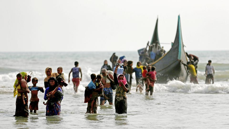 Rohingya refugees walk to the shore after crossing the Bangladesh-Myanmar border by boat through the Bay of Bengal in Teknaf, Bangladesh, September 5, 2017. At least five children were killed when several boats carrying Rohingya refugees from Myanmar sank early Wednesday, Bangladesh border guards told AFP. Deaths among refugees resulting from boats capsizing were also reported earlier this week killing 26. (Mohammad Ponir Hossain / Reuters)