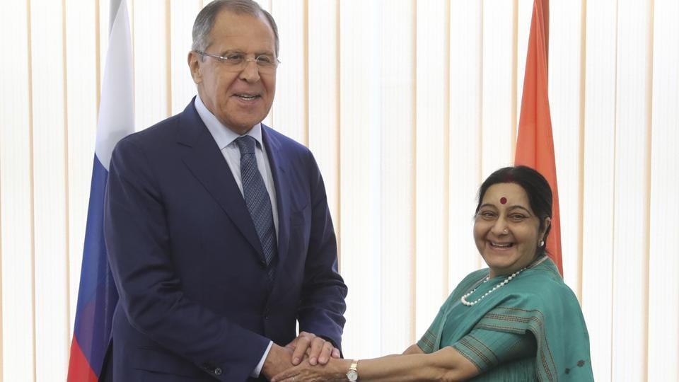 Russian foreign minister Sergey Lavrov, left, and his Indian counterpart Sushma Swaraj smile during their meeting at the Eastern Economic Forum in Vladivostok, Russia.