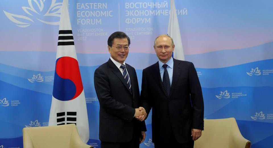 Russian President Vladimir Putin (R) and President of South Korea Moon Jae-in shake hands during their meeting as part of the 3rd Eastern Economic Forum hosted by the Far Eastern Federal University at Russky Island outside Vladivostok on September 6.