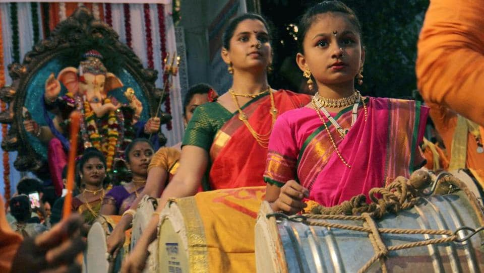 On the last day of Ganpati Visarjan, Vainavi Parag Mohite, dressed in a traditional Maharashtrian saree took to the streets along with her group to play a traditional Nashik Dhol and bid adieu to Lord Ganesha. At 11, she is one of the city's youngest Nashik Dhol players. (Pramod Thakur/HT PHOTO)