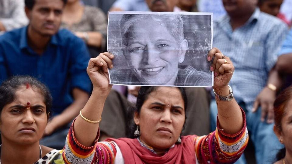 Protesters take part in a rally condemning the killing of journalist Gauri Lankesh in Bangalore on September 6. Activists, politicians and journalists demanded a full investigation on September 6 into the murder of Lankesh, a newspaper editor and critic of Hindutva.