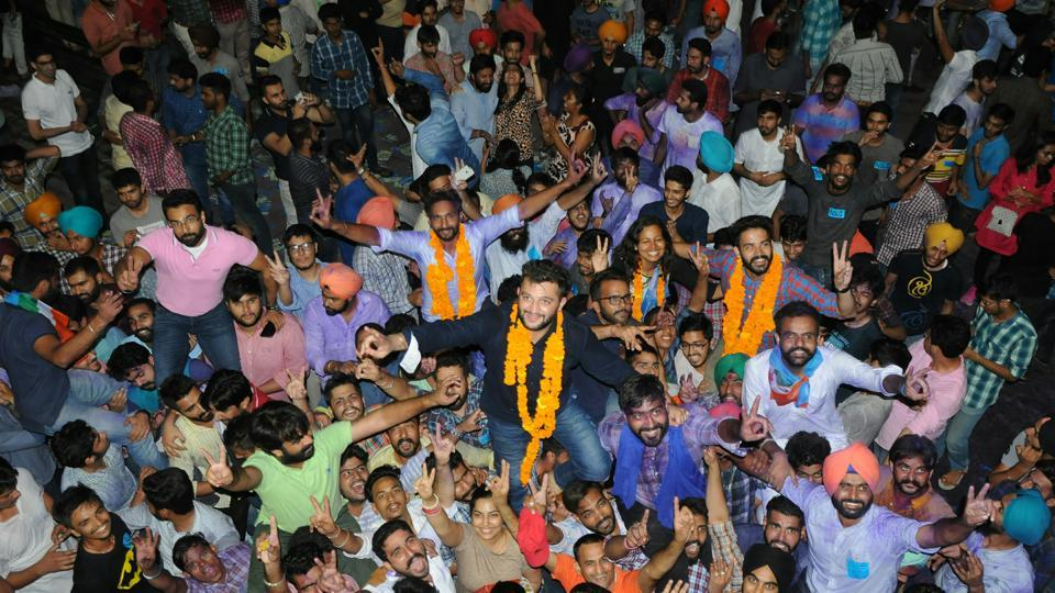 Students celebrate after NSUI won three key pots in the Panjab University student election on Thursday.