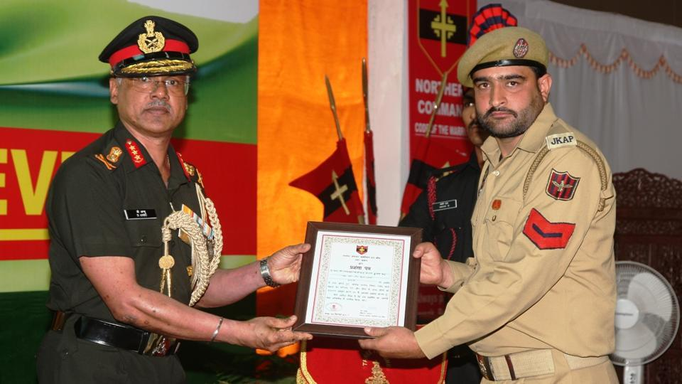 Northern army chief Lt General Devraj Anbu poses with a soldier during an investiture ceremony in  Udhampur on Thursday.
