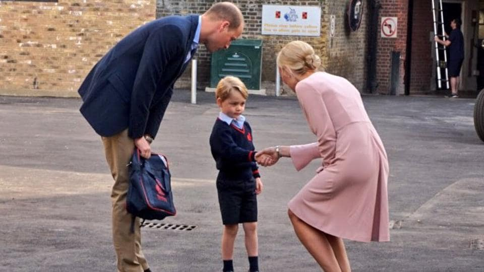 Britain's Prince George started his first day of school on Thursday but palace officials said his pregnant mother Kate was too unwell to attend and he was dropped off by his father Prince William.