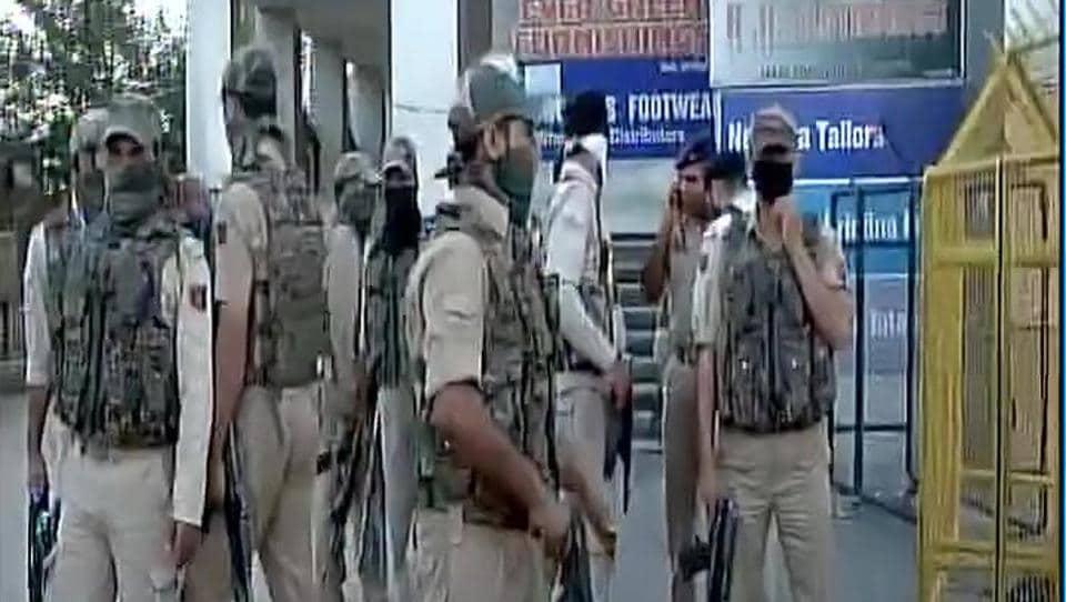 Securitymen take position after a grenade blast in Srinagar on Thursday.