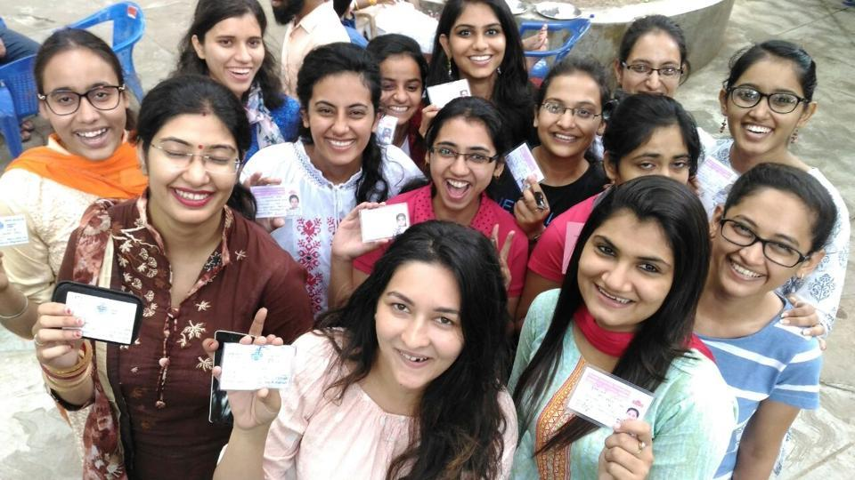 Students show their PU identity cards at the Panjab University campus on Thursday.