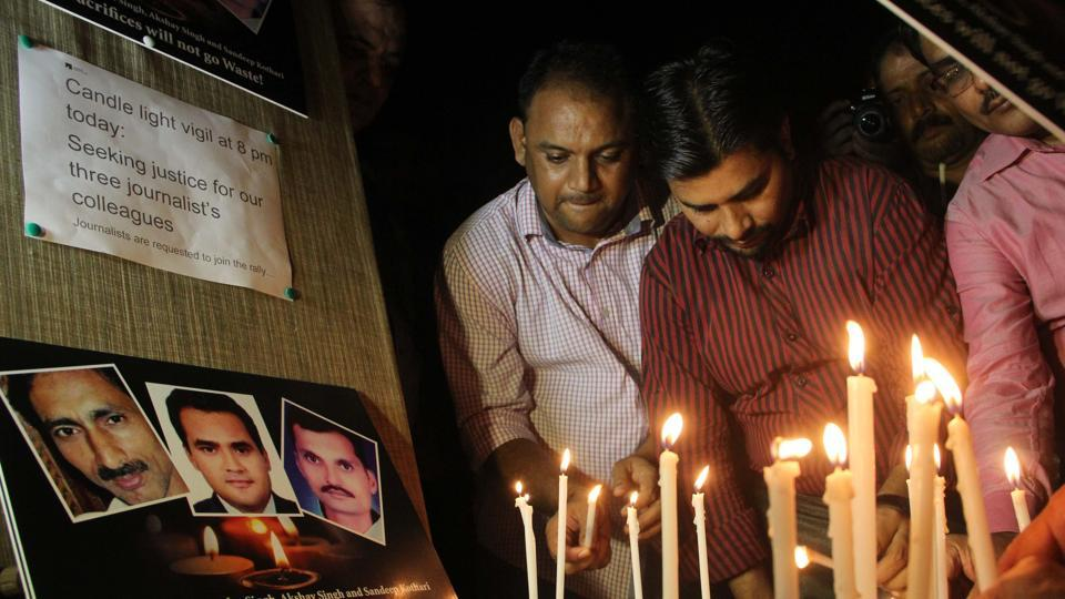 Candle light vigil seeking justice for journalists Akshay Singh, Jagendra Singh and Sandeep Kothari; who died in line of their work. Jagendra and Sandeep Kothari were brutally murdered, while Akshay Singh died in suspicious circumstances when probing the Vyapam scam. (Bhushan Koyande / HT Photo)