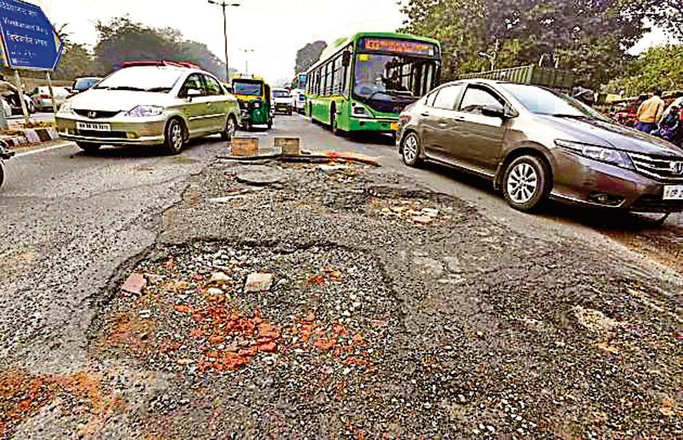 New Delhi, India- January 14, 2015: Badly damaged Vivekanand Road, in New Delhi, India, on Thursday, January 14, 2016. (Photo by Sonu Mehta/ Hindustan Times)
