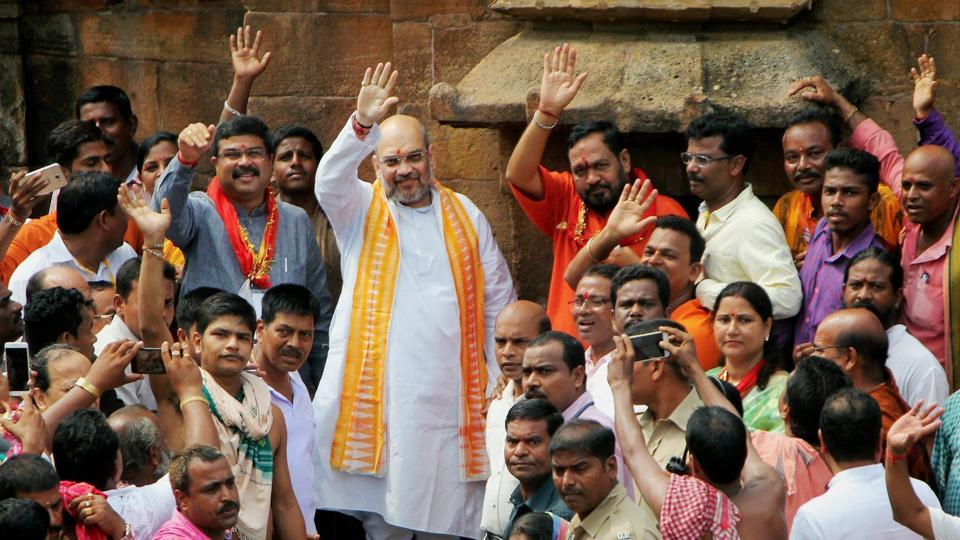 BJP national president Amit Shah, minister for petroleum and natural gas Dharmendra Pradhan & BJP State President Basanta Panda wave to supporters during a visit to Lord Lingaraj Temple in Bhubaneswar on Thursday.