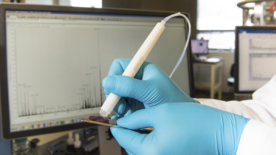 This photo provided by the University of Texas at Austin shows the MasSpec Pen, a handheld probe that can non-destructively analyze human tissue samples to identify cancer.