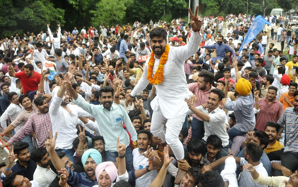 Vikas of DAV College, Sector 10, celebrating  with his supporters after he was elected as the president. (Karun sharma/HT)