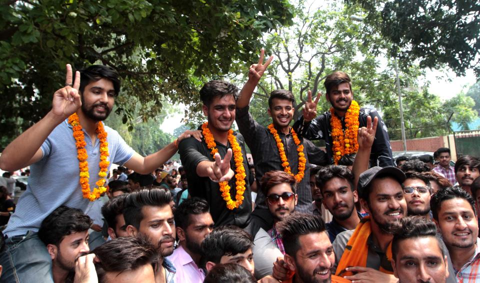 (From right) President Harsh Sharma, secratry Nitin Thakur, vice-president Harmanveer Singh and joint secretary Deepak Phor celebrating their victory at SD College in Sector 32 in Chandigarh. (Ravi Kumar/HT)