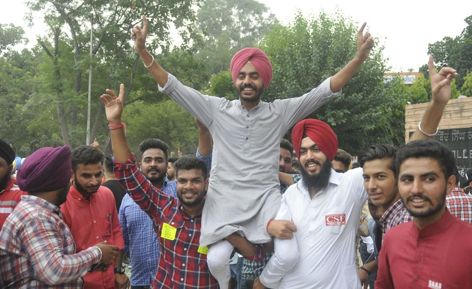 Sukhvir Singh celebrating outside Shri Guru Gobind Singh College in Sector 26. (Karun Sharma/HT)
