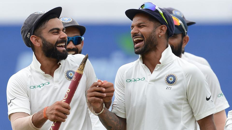 Indian cricket team captain Virat Kohli (L) celebrates with teammate Shikhar Dhawan after their victory in the third Test match against Sri Lanka.