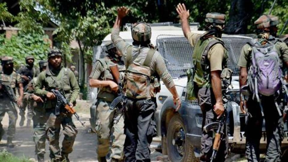 Army soldiers in action outside a house where militants were hiding during an encounter in which top three Hizbul Mujahideen Commanders and two Army soldiers were killed, at Awneera in Shopian.