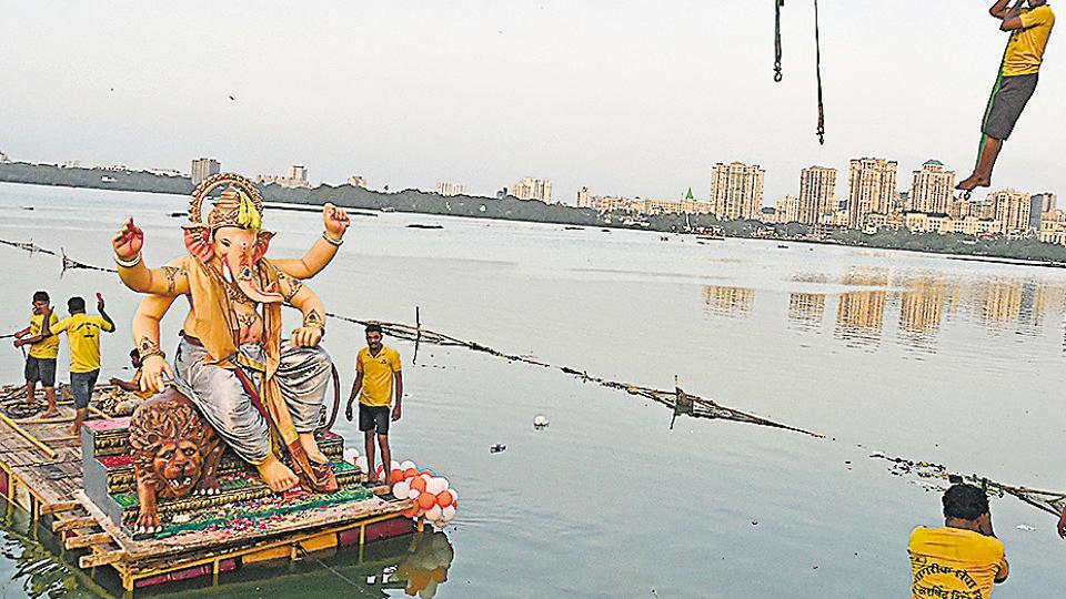 Devotees use a raft for immersion in Mumbai on Tuesday.