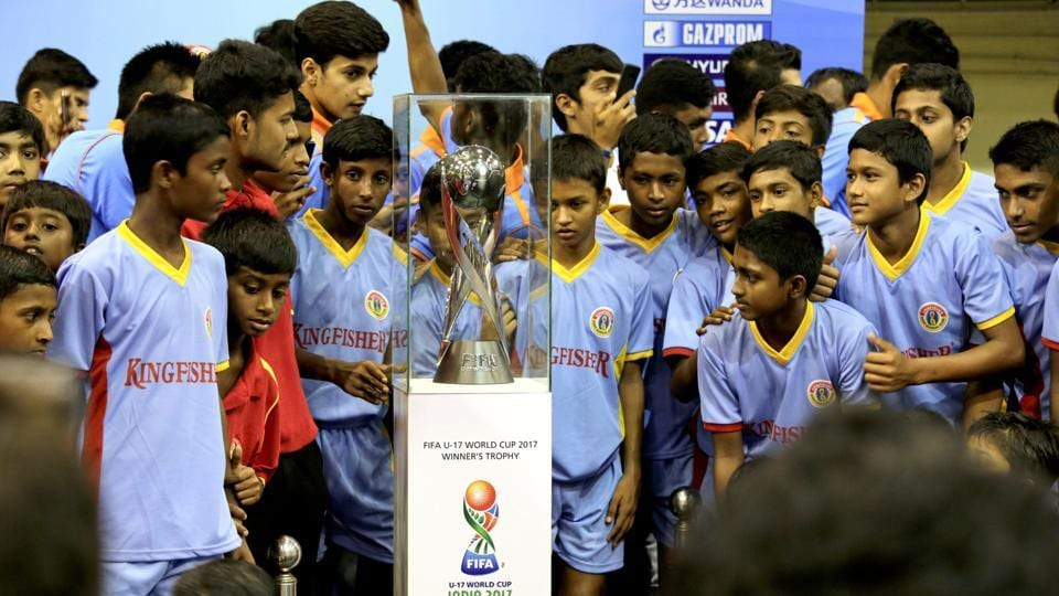 Indian children look at the FIFA U-17 World Cup trophy during its unveiling for public viewing in Kolkata.
