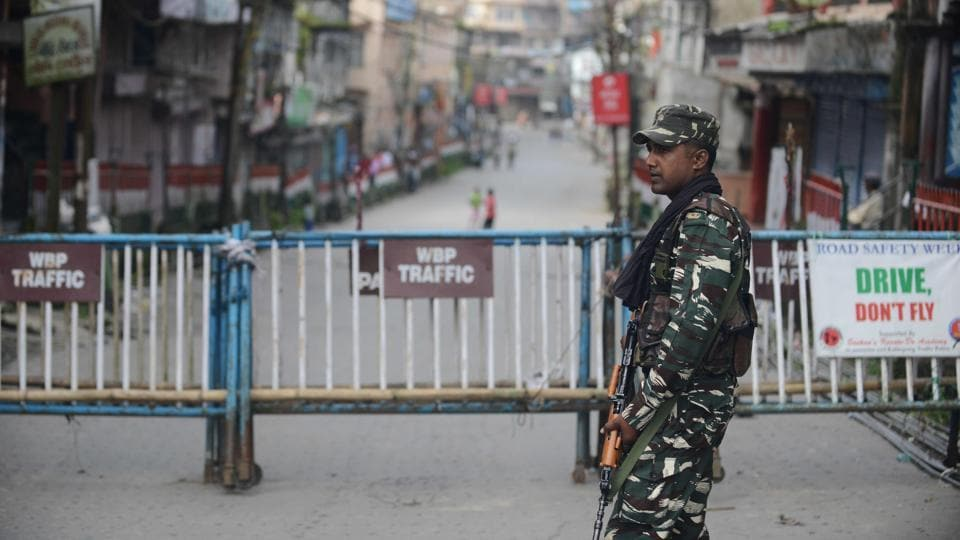 Paramilitary forces stand guard along a road during the 83th day of an indefinite strike called by the Gorkha Janmukti Morcha (GJM) for separate state Gorkhaland in Kalimpong on September 3.