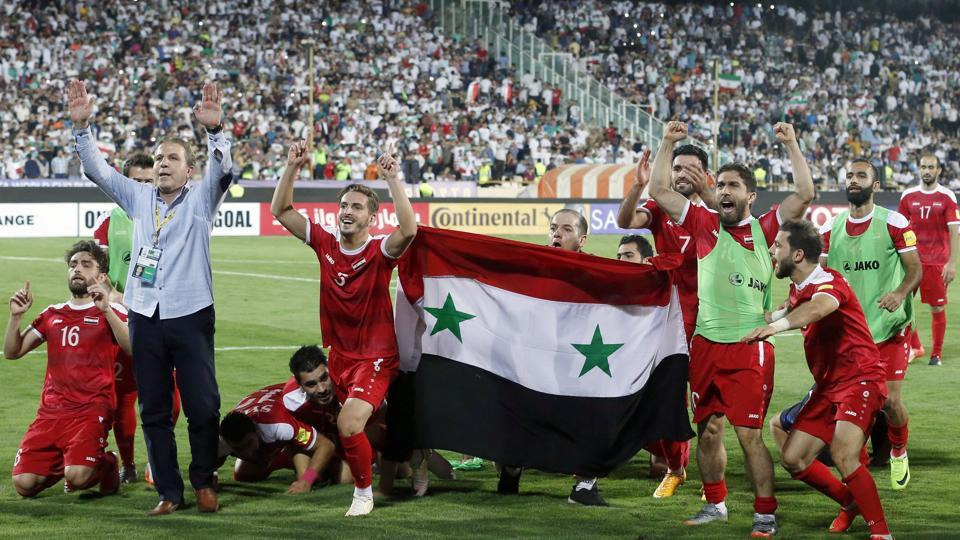 Syria's players celebrate at the end of their FIFA World Cup 2018 qualification football match against Iran at the Azadi Stadium in Tehran.