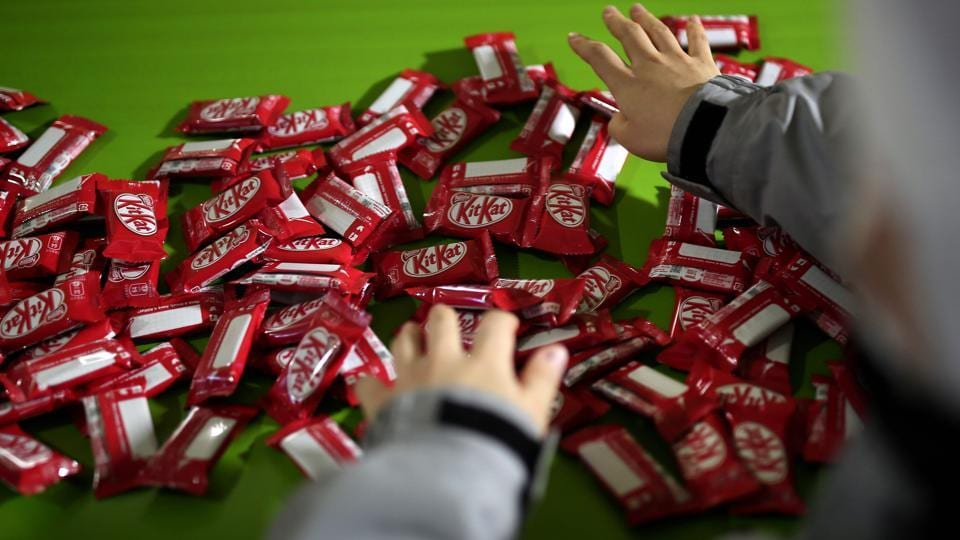 Cough medicine flavoured KitKat anyone? While it may not be to everyone's taste, this is just one of 300 weird and wonderful flavours of the four-fingered snack available in the Japanese market, and they're flying off the shelves!  (Behrouz Mehri / AFP)