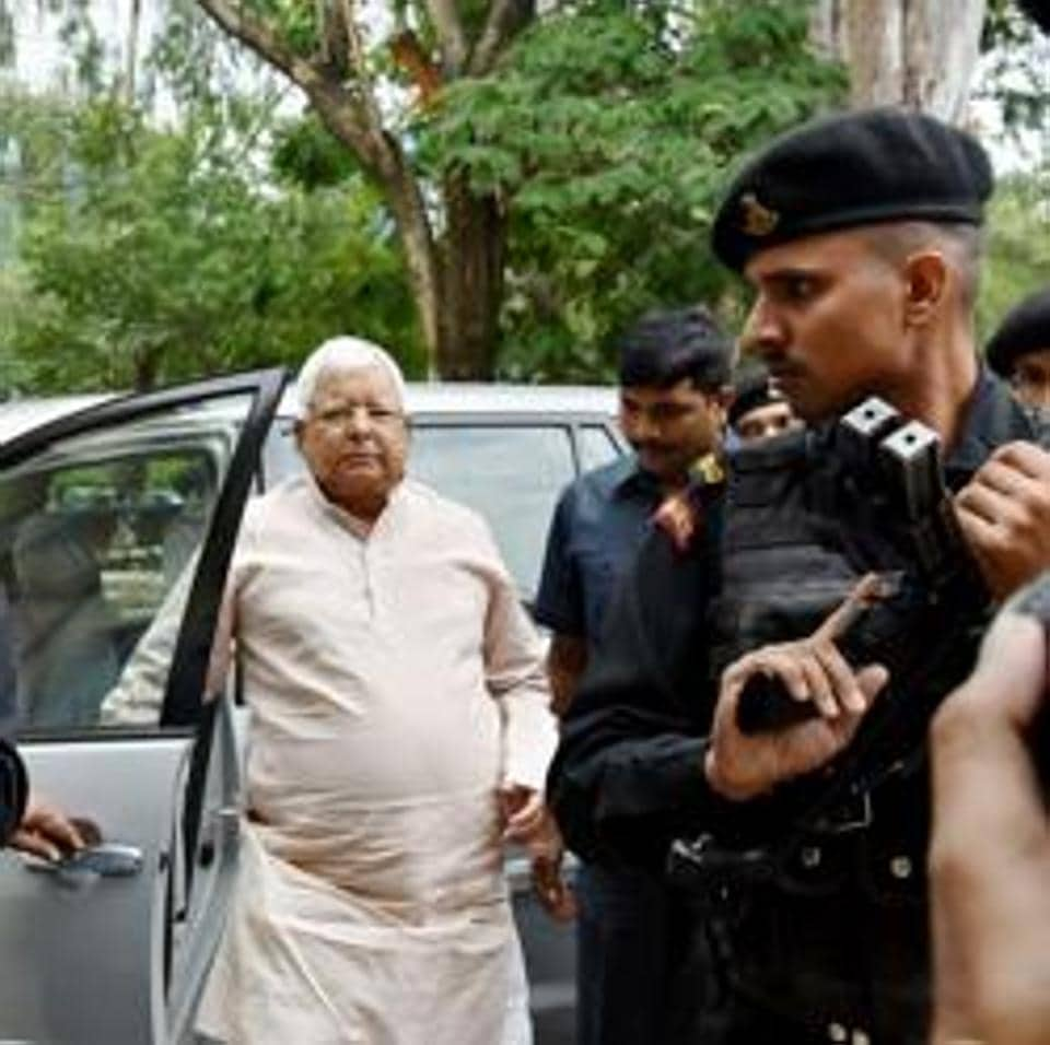 Former chief minister of Bihar and RJD chief Lalu Prasad Yadav arrives to appear in special CBI court in connection with the multi-crore fodder scam case, in Ranchi on Thursday.