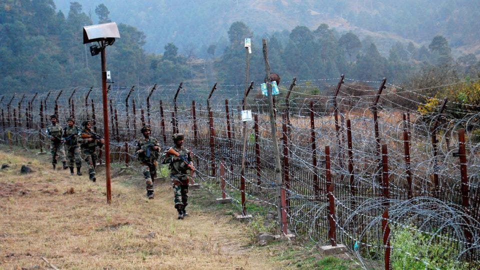Army soldiers stand guard at the LoC in Poonch district.