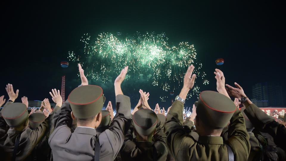 Korean People's Army soldiers cheer during a mass celebration in Pyongyang for scientists involved in carrying out North Korea's largest nuclear blast to date.