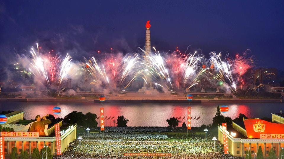 Fireworks on display as residents and military people hold a celebration rally at Kim Il Sung Square in Pyongyang.