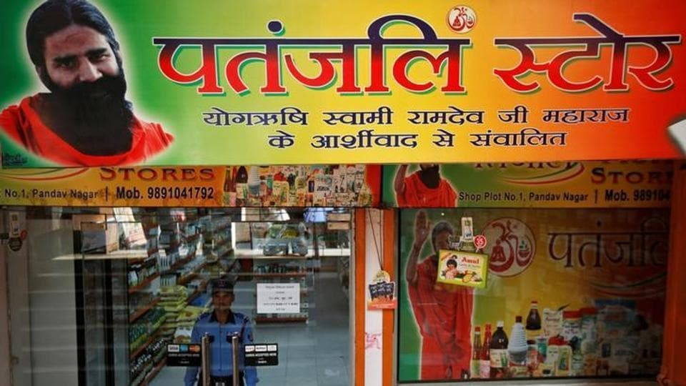 A private security guard stands inside a Patanjali store in New Delhi.