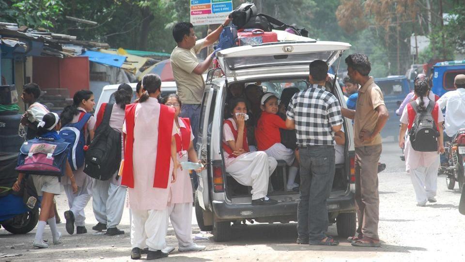 A van packed with school children in Doon.