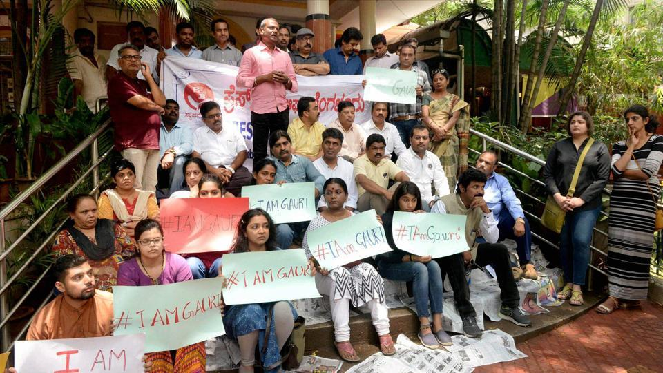 Journalists hold placards during a protest against the killing of journalist Gauri Lankesh in Bengaluru on Wednesday.