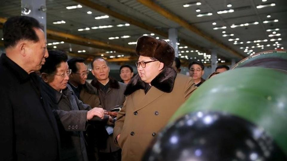 North Korean leader Kim Jong Un meets scientists and technicians in the field of researches into nuclear weapons in this undated photo released by North Korea's Korean Central News Agency in Pyongyang.